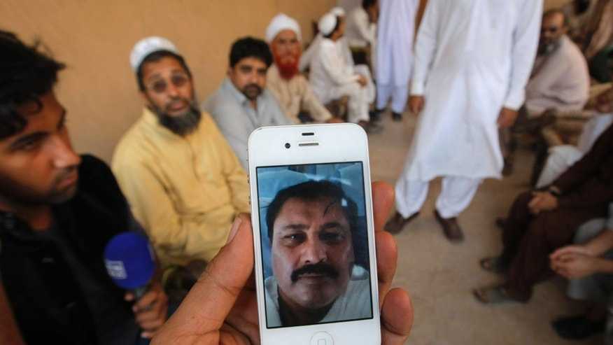 Sept. 27, 2015 - A Pakistani man shows the picture of Sher Afzal Khan-- reportedly killed  in a crush during the Hajj pilgrimage in Saudi Arabia. Saudi Arabia has given foreign diplomats some 1,100 photographs of the dead from last week's hajj stampede, Indian and Pakistani authorities said, an indication of a significantly higher death toll than previously offered by the kingdom.