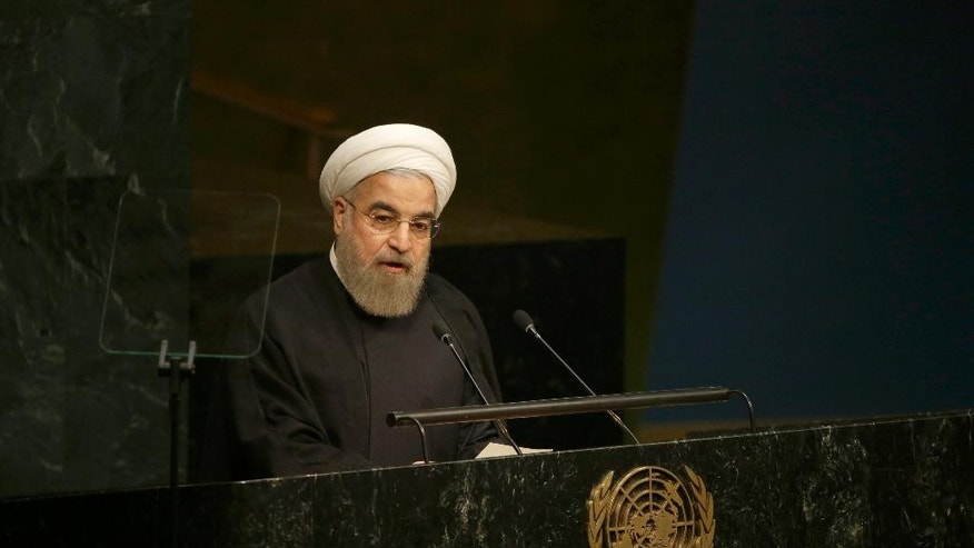"FILE - In this Sept. 26, 2015, file photo, Iran's President Hassan Rouhani addresses the Sustainable Development Summit 2015 at United Nations headquarters. Rouhani said in a meeting Sunday evening with scholars and think tank experts that Iran will cooperate with any country that puts fighting and defeating ""terrorism"" as its top priority — but it cannot work with any government that makes a change in Syria's regime its top priority. (AP Photo/Mary Altaffer, File)"