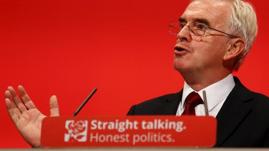 Britain's Labour Party's Shadow Chancellor of the Exchequer John McDonnell, makes his keynote speech at the Labour Party annual conference in the Brighton Centre in Brighton, England, Monday Sept.  28, 2015. McDonnell spok out strongly against the government's austerity measures and called for increased taxation of wealthy members of society.  (Gareth Fuller/PA  via AP) UNITED KINGDOM OUT