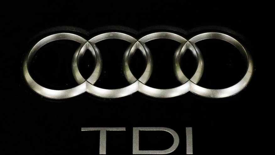 The sign of German car company Audi is attached on the engine of a TDI, a turbo diesel model, in Berlin, Germany, Monday, Sept. 28, 2015. Volkswagen AG's upmarket Audi brand said 2.1 million of its vehicles are among those with the engines affected by the emissions-rigging scandal. (AP Photo/Markus Schreiber)