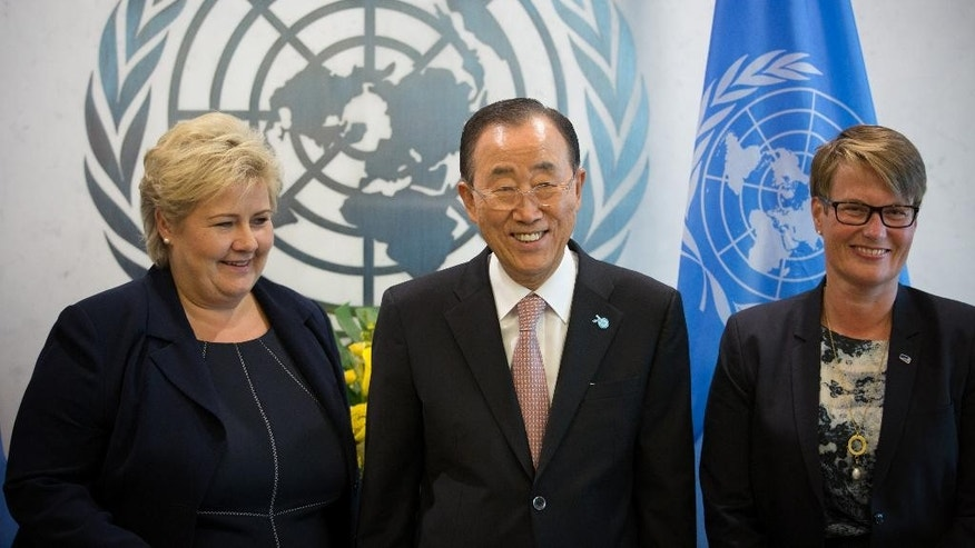 Norwegian Prime Minister H.E. Ms. Erna Solberg, left, poses with Secretary-General Ban Ki-moon, center, and Norwegian Climate Minister Tine Sundtoft at the United Nations headquarters Friday, Sept. 25, 2015. The United Nations is conducting the Sustainable Development Summit with the goal of adopting of a post-2015 development agenda. (AP Photo/Kevin Hagen)