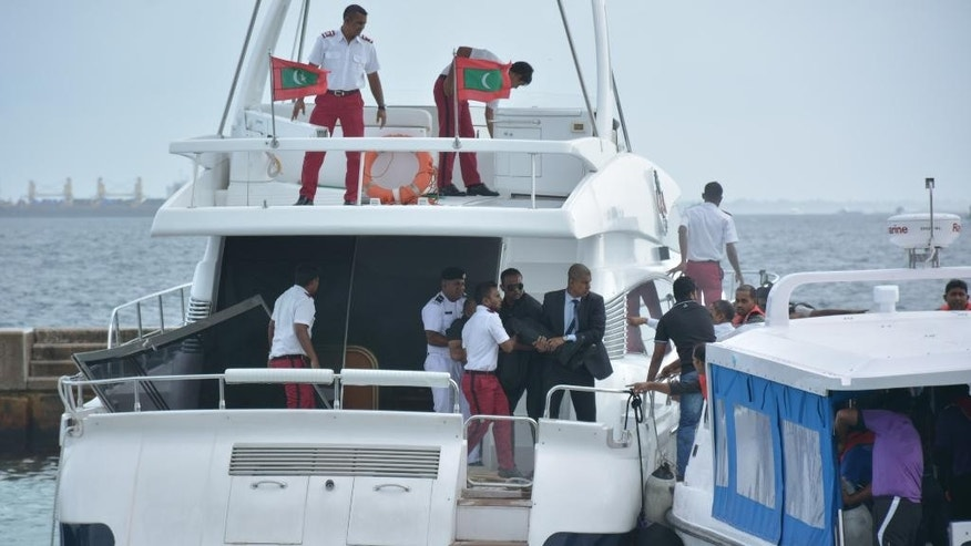 Unidentified injured people are evacuated after a blast on the Maldives President Yameen Abdul Gayoom speedboat in Male, Maldives Monday, Sept. 28, 2015. Gayoom's wife Fathimath Ibrahim and several officials suffered minor injuries. The country's international airport is on a separate island and a short boat trip is needed to reach the capital island. (Yoosuf Sofwan/Sun Online via AP) NO ARCHIVE NO SALES