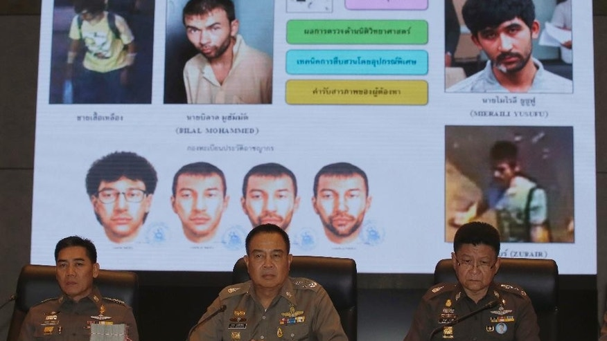 Thai National Police Chief Somyot Poomphanmuang, center, Deputy Police Chief Jakthip Chaijinda, left, and Police spokesman Prawut Thavornsiri sit in front of a chart of suspect bombers during a press conference in Bangkok, Thailand, Monday, Sept. 28, 2015. Police have given their most detailed explanation yet of who they believe was behind last month's deadly bombing in Bangkok, for the first time publicly linking one of the suspects to previous explosions. Authorities have said they believe the Aug. 17 bombing, which killed 20 people and injured more than 120, was carried out by a people smuggling gang seeking revenge for having their operation curbed. (AP Photo/Sakchai Lalit)