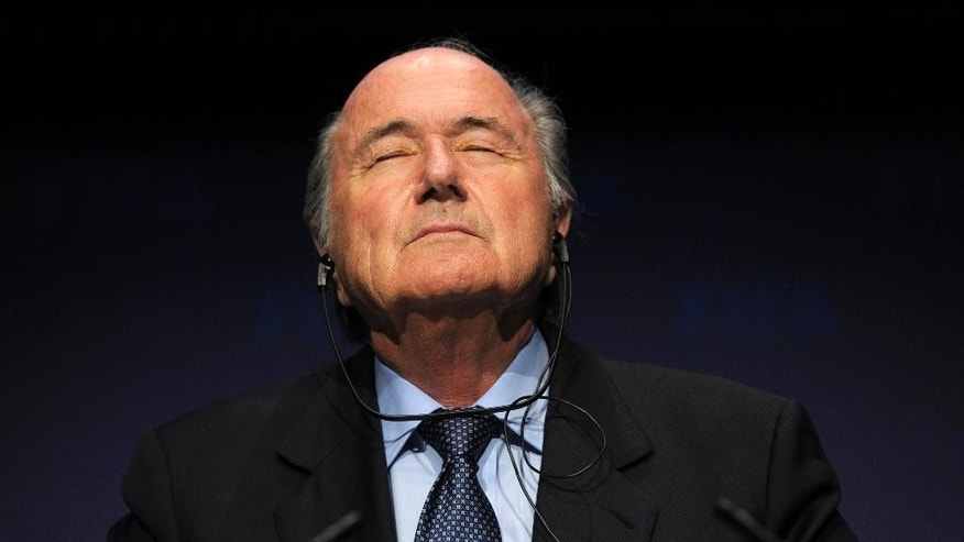 FILE - In this Nov. 19, 2010 file photo FIFA President Sepp Blatter pauses during a press conference following a meeting of the Executive Committee in Zurich, Switzerland. On Friday, Sept. 25, 2015 Swiss attorney general opened criminal proceedings against FIFA President Sepp Blatter.   (Steffen Schmidt/Keystone via AP)