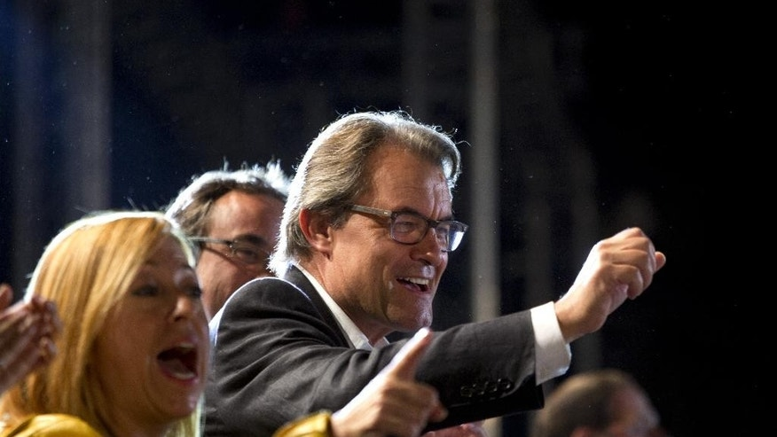 The President of Democratic Convergence of Catalonia Artur Mas waves to supporters in Barcelona, Spain, Sunday Sept. 27, 2015. Catalonia leader Artur Mas claimed victory in a parliamentary election for pro-secession parties pushing for independence from Spain. (AP Photo/Emilio Morenatti)