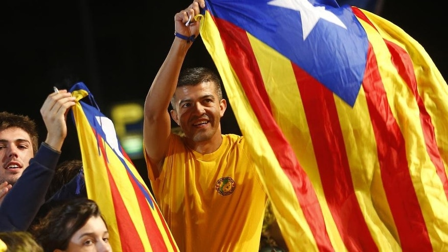Catalonian pro-independence supporters celebrate in Barcelona, Spain, Sunday Sept. 27, 2015. Catalonia leader Artur Mas claimed victory in a parliamentary election for pro-secession parties pushing for independence from Spain. (AP Photo/Francisco Seco)