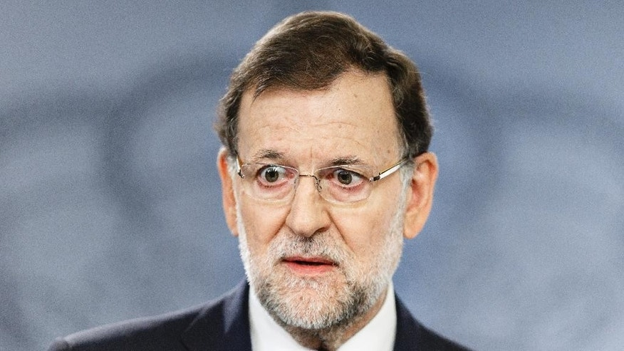 Spain Prime Minister, Mariano Rajoy, speaks during a press conference at the Moncloa Palace in Madrid, Spain, Monday, Sept. 28, 2015. In its first official reaction to the Catalonia vote, the Spanish government reiterated the Spanish state would not be split and that there would be no independence.(AP Photo/Daniel Ochoa de Olza)