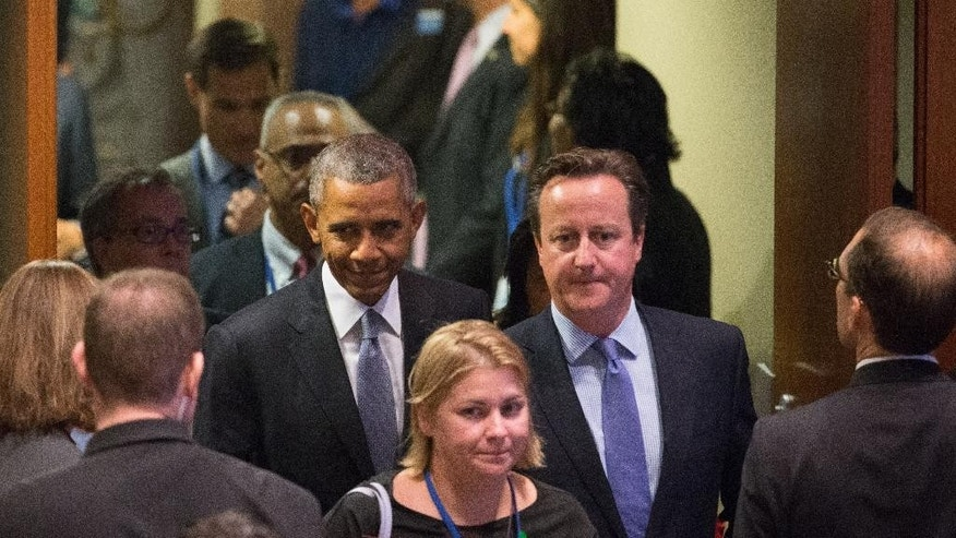 President Barack Obama and British Prime Minister David Cameron, right, arrive for a United Nations Peacekeeping Summit, Monday, Sept. 28, 2015, at United Nations headquarters. (AP Photo/Andrew Harnik)