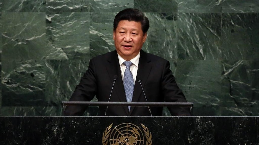China's President Xi Jinping addresses the 70th session of the United Nations General Assembly, Monday, Sept. 28, 2015. (AP Photo/Richard Drew)