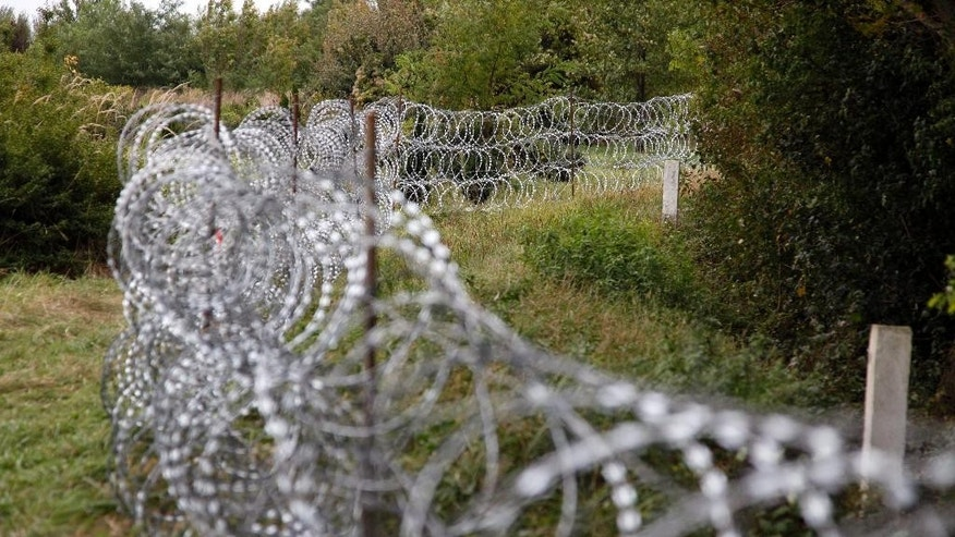 A part of the temporary fence is seen at the green border between Hungary and Croatia at Zakany, 234 kms southwest of Budapest, Hungary, Tuesday, Sept. 29, 2015. (Gyorgy Varga/MTI via AP)