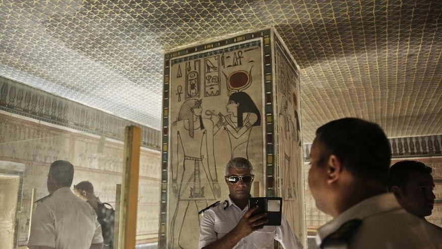 A policeman takes a selfie at the Amenhotep II tomb in the Valley of the Kings in Luxor, Egypt, Tuesday, Sept. 29, 2015. Egypt's antiquities minister says King Tut's tomb may contain hidden chambers, lending support to a British Egyptologist's theory that a queen may be buried in the walls of the 3,300 year-old pharaonic mausoleum. (AP Photo/Nariman El-Mofty)