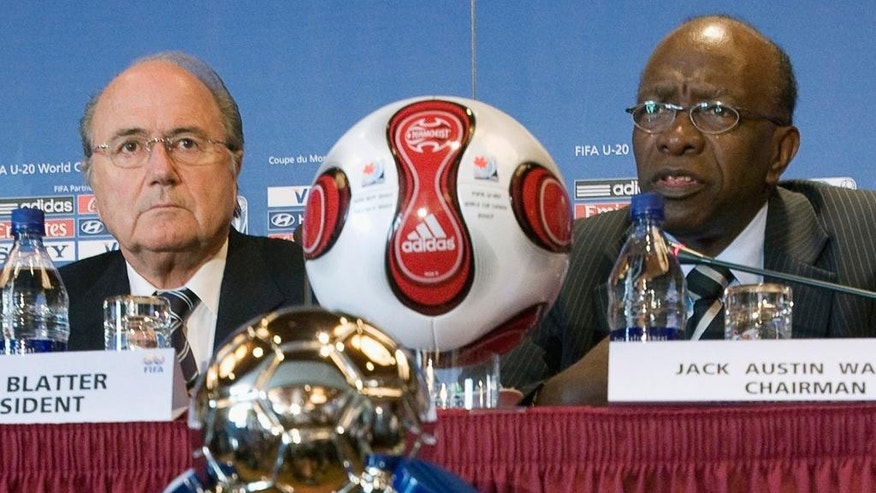"FILE - In this July 20, 2007 file photo Joseph ""Sepp"" Blatter, left, president of FIFA, listens to Jack Warner, chairman of the tournament during a news conference as part of the FIFA U-20 World Cup in Toronto, Canada. FIFA said Tuesday, Sept. 29, that Warner will be banned for life from soccer related activities. (Paul Chiasson, CP via AP, file)"
