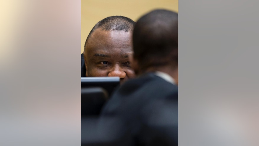 Former Congo vice president Jean-Pierre Bemba looks up when sitting in the court room of the International Criminal Court to stand trial with Aime Kilolo Musamba, Jean-Jacques Mangenda Kabongo, Fidele Babala Wandu and Narcisse Arido, on charges including corruptly influencing witnesses by giving them money and instructions to provide false testimony, and presenting false evidence, in The Hague, Netherlands, Tuesday, Sept. 29, 2015. (AP Photo/Peter Dejong, Pool)