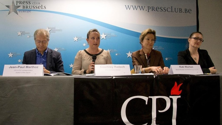 From left, EU correspondent for the Committee to Protect Journalists, Jean-Paul Marthoz, Advocacy Director for the CPJ, Courtney Radsch, Board member and former chairperson for the CPJ, Kati Marton and Central Asia Program Coordinator for the CPJ, Nina Ognianova address a media conference  in Brussels on Tuesday, Sept. 29, 2015. The New York-based Committee to Protect Journalists said in a report on Tuesday's that the 28-nation bloc was struggling to match its lofty human rights standards with its day-to-day actions in protecting journalists around the world. (AP Photo/Virginia Mayo)