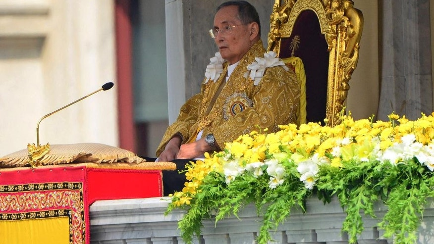FILE - In this Dec. 5, 2012 file photo, Thai King Bhumibol Adulyadej appears to address a crowd from the balcony at the Anantha Samakhom Throne Hall in Bangkok, Thailand, during his 85th birthday celebration. Thailand's royal palace said in a statement that doctors reported Monday, Sept. 28, 2015, that a blood test and a chest X-ray of King Bhumibol Adulyadej showed that infections detected in early September had cleared up. It said the king's pulse, blood pressure, breathing, blood oxygen level and body temperature were normal.(AP Photo/Sakchai Lalit, File)