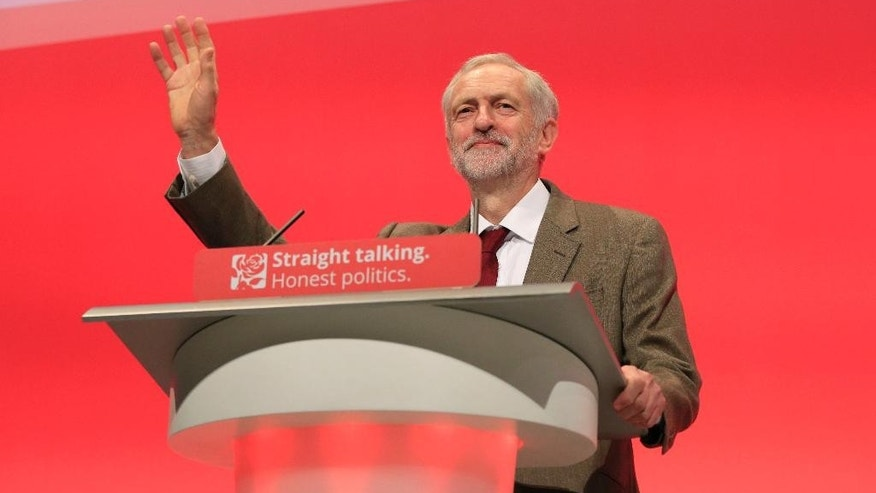 Labour Party leader Jeremy Corbyn makes his first keynote speech since being elected leader of the party, during the third day of the Labour Party conference at the Brighton Centre in Brighton, Sussex, England, Tuesday, Sept. 29, 2015. (Jonathan Brady/PA via AP)      UNITED KINGDOM OUT     -    NO SALES     -     NO ARCHIVES