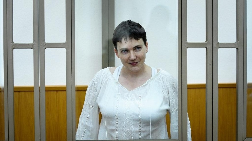 Ukrainian jailed military officer Nadezhda Savchenko stands in a cage during a court hearing in a town of Donetsk, Rostov-on-Don region, Russia, on Tuesday, Sept. 29, 2015. The Russian court has begun hearing the high-profile case against Ukrainian officer Nadezhda Savchenko, who is charged in the deaths of two Russian journalists in eastern Ukraine. Russian investigators allege that Savchenko, who served in a volunteer battalion fighting with government troops against Russia-backed rebels, provided the coordinates for a mortar attack that killed the journalists in June 2014. (AP Photo)