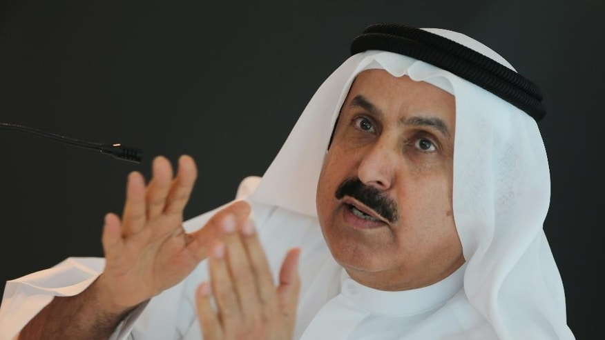 UAE Minister of Labor Saqr Ghobash talks to the journalists during a press briefing to introduce new Ministerial Decree, Tuesday, Sept. 29, 2015, in Abu Dhabi, United Arab Emirates. The United Arab Emirates is introducing labor reforms that aim to tighten oversight of employment agreements for the millions of temporary migrant workers that comprise the bulk of the country's workforce, a top Emirati official said Tuesday. (AP Photo/Kamran Jebreili)