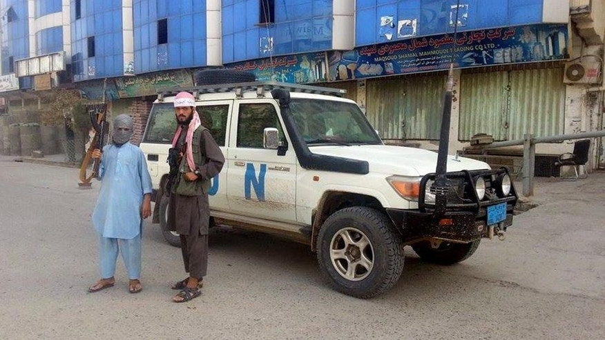 Taliban fighters pose for a photo next to a UN vehicle which they are using, in Kunduz, Afghanistan, Tuesday, Sept. 29, 2015. The U.S. military carried out an airstrike on Tuesday on the northern Afghan city of Kunduz, which was captured by the Taliban the previous day in a major setback to the government of Afghan President Ashraf Ghani. (AP Photo)