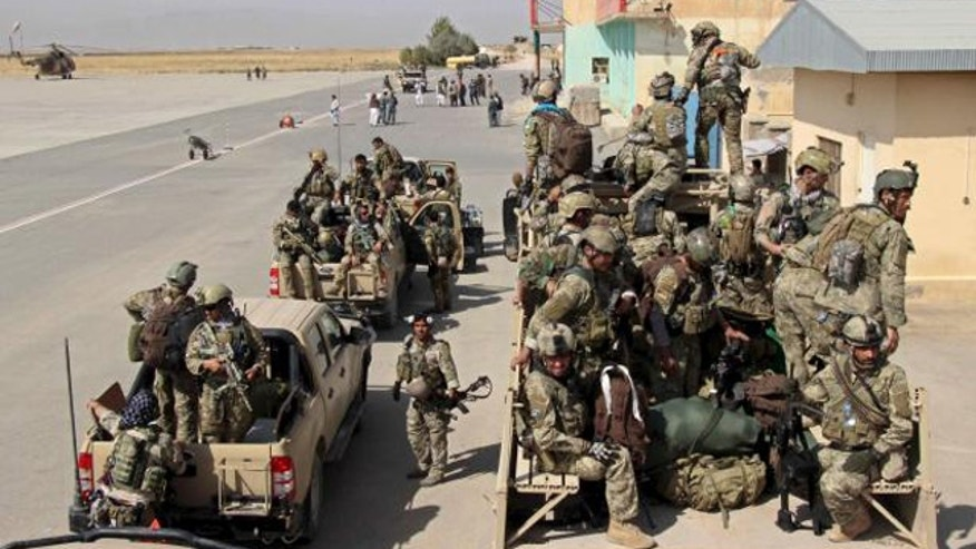 Sept. 29, 2015: Afghan special forces arrive for a battle with the Taliban in Kunduz. (Reuters)