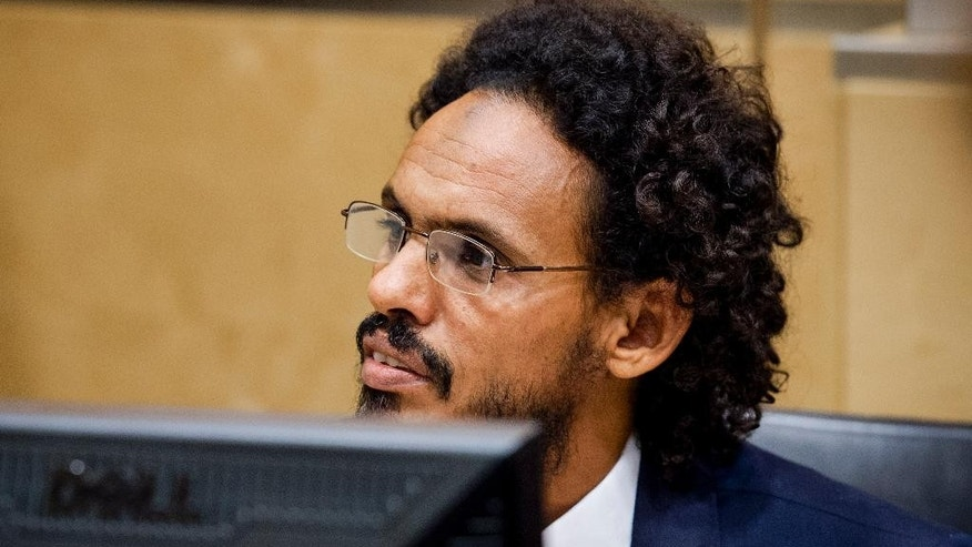 Ahmad Al Mahdi Al Faqi takes his seat in the  court room for his initial appearance at the International Criminal Court in The Hague, Netherlands, Wednesday, Sept. 30, 2015. Al Faqi, an alleged Islamic radical, is the first suspect in the court's custody charged with the war crime of deliberately attacking and destroying religious or historical monuments in Timbuktu, Mali. (AP Photo/Robin van Lonkhuijsen, Pool)