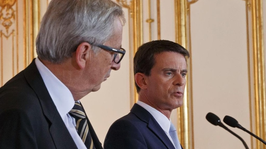 French Prime Minister Manuel Valls, right, speaks during a joint media conference with European Commission President Jean-Claude Juncker, left, at the Hotel Matignon in Paris, France, Tuesday, Sept. 29, 2015. French Prime Minister Manuel Valls and European Commission President Jean-Claude Juncker discussed on Tuesday the economic situation in France. (AP Photo/Michel Euler)