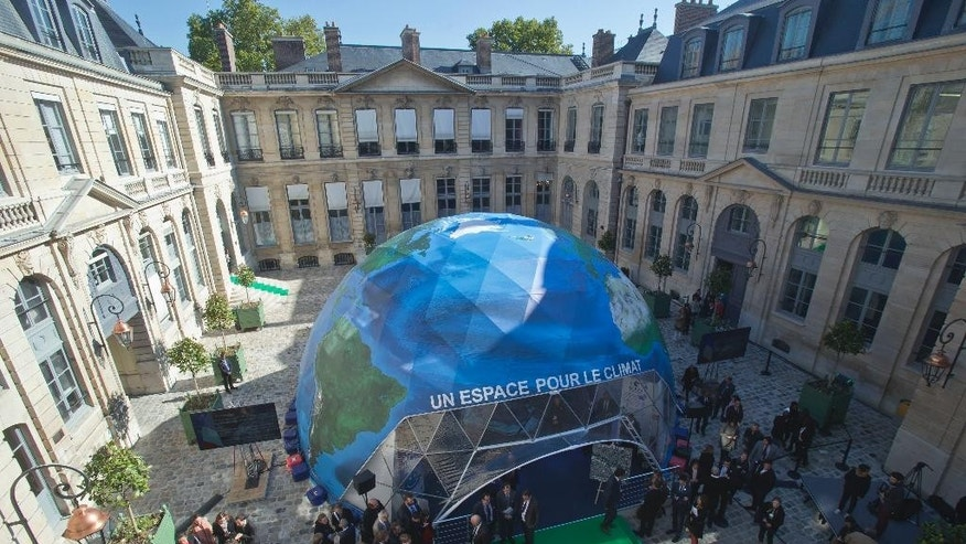 A general view of a dome representing the Earth,  at France's environment ministry, which is hosting a global climate exhibition, in Paris, France, Wednesday, Sept. 30, 2015. The exhibition who promote the Climate Change Conference 2015,  is organized by the French government. (AP Photo/Michel Euler, Pool)