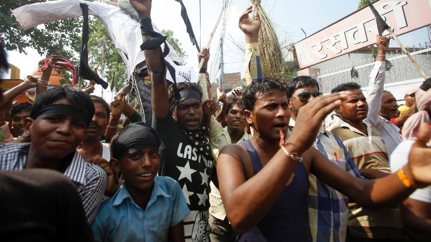 Protestors belonging to ethnic and religious groups, dissatisfied with Nepal's new constitution, raise slogans during a protest in Janakpur, Nepal, Tuesday, Sept. 29, 2015. Nepal started imposing restrictions on the movement of vehicles on Sunday as a blockade of cargo trucks trying to enter the country from neighboring India continued to severely limit supplies of fuel and other essential commodities. Trucks carrying supplies from India stopped entering Nepal this past week amid angry protests following the adoption of a new constitution. (AP Photos/Bikram Rai)