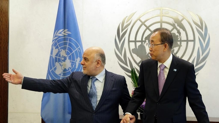 United Nations Secretary-General Ban Ki-moon, right, meets Iraqi Prime Minister Haider Al Abadi, at U.N. Headquarters, Wednesday, Sept. 30, 2015. (AP Photo/Mary Altaffer)