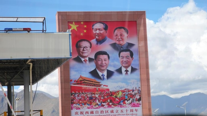 In this Thursday, Sept. 17, 2015 photo, a billboard displaying Chinese leaders, clockwise from far left, Jiang Zemin, Mao Zedong, Deng Xiaoping, Hu Jintao, and Xi Jinping, sits alongside a highway in Lhasa, capital of the Tibet Autonomous Region of China. Top-down development has poured more than $100 billion dollars into the region since 1952, but critics say that Beijing's obsession with social stability also has led to widespread human right abuses. (AP Photo/Aritz Parra)