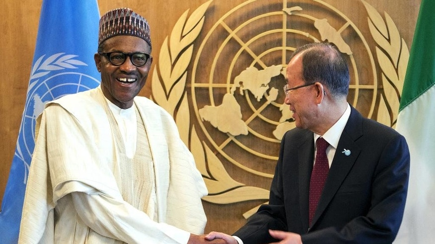 Nigeria's President Muhammadu Buhari, left, shakes hands with United Nations Secretary-General Ban Ki-moon as they meet during the 70th session of the United Nations General Assembly at U.N. headquarters, Monday, Sept. 28, 2015. (AP Photo/Craig Ruttle)