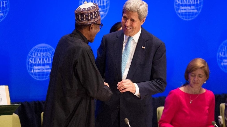 Unites States Secretary of State John Kerry greets Nigeria's President Muhammadu Buhari during the Leaders' Summit on Countering ISIL and Violent Extremism at the United Nations headquarters Tuesday, Sept. 29, 2015. (AP Photo/Kevin Hagen)