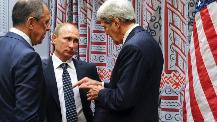 Russian President Vladimir Putin, center, and Foreign Minister Sergey Lavrov, left, listen to U.S. Secretary of State John Kerry, right, before a bilateral meeting at United Nations headquarters in New York, Monday, Sept. 28, 2015. (Mikhail Klimentyev, RIA-Novosti, Kremlin Pool Photo via AP)