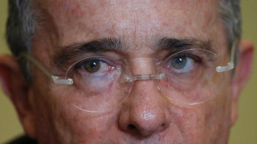 Colombia´s Senator and former President Alvaro Uribe listens to a question during an interview with The Associated Press in Bogota, Colombia, Thursday, Oct. 1, 2015. The hardline leader said it's incoherent for the U.S. and Europe to demand jail time for terrorists from Spanish separatist group ETA, the Irish Republican Army or al-Qaida but expect Colombia to demonstrate leniency with the Revolutionary Armed Forces of Colombia and invite its leaders behind scores of atrocities to partake in electoral politics. (AP Photo/Fernando Vergara)