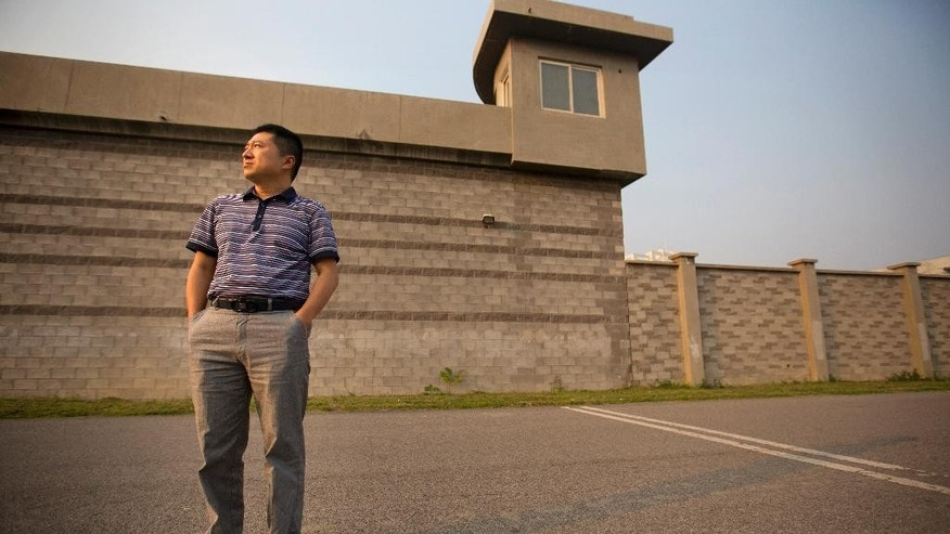 In this Sept. 16, 2015 photo, Chinese journalist Liu Hu poses for a portrait as he stands outside the detention center where he was held on the outskirts of Beijing. Liu, who was ultimately cleared when prosecutors decided not to bring any charges against him, recounted in an interview with the Associated Press how Chinese police - in cooperation with the state propaganda machine - try to draw out confessions and air them on state television to shame suspects and sway public perceptions ahead court trials. (AP Photo/Mark Schiefelbein)