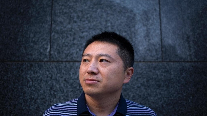 In this Sept. 16, 2015 photo, Chinese journalist Liu Hu poses for a photo in Beijing. Liu, who was ultimately cleared when prosecutors decided not to bring any charges against him, recounted in an interview with the Associated Press how Chinese police - in cooperation with the state propaganda machine - try to draw out confessions and air them on state television to shame suspects and sway public perceptions ahead court trials. (AP Photo/Mark Schiefelbein)
