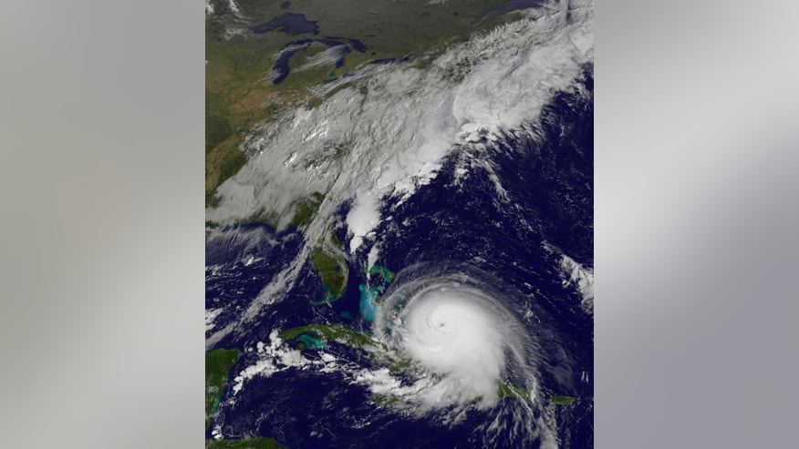 This satellite image taken Thursday, Oct. 1, 2015 at 9:37 a.m. EDT, and released by the National Oceanic and Atmospheric Administration (NOAA), shows Hurricane Joaquin. The powerful Category 4 hurricane pounded lightly populated islands of the eastern Bahamas on Thursday, and forecasters said it could grow more intense while following a path that would near the U.S. East Coast by the weekend. (NOAA via AP)