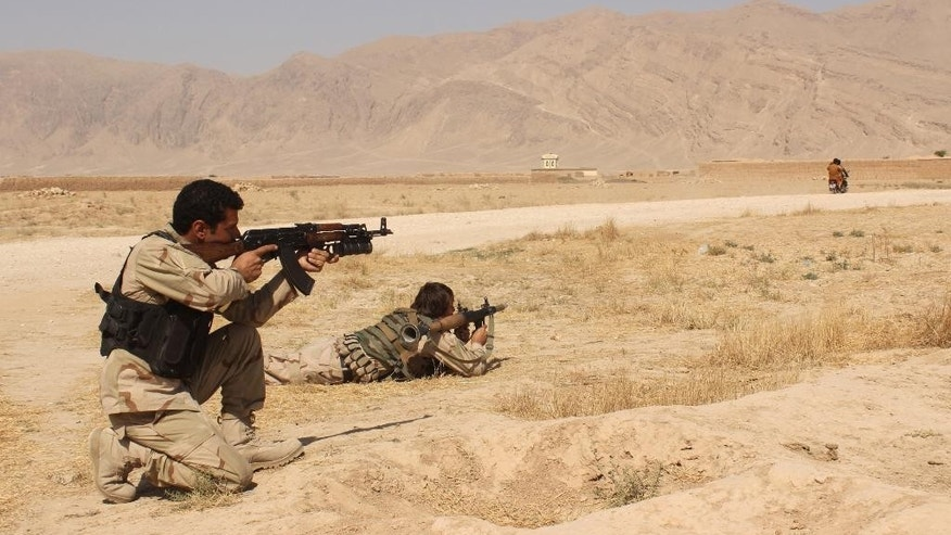 Afghanistan's security forces take their position during a clash by Taliban fighters in the highway between Balkh province to Kunduz city, north of Kabul, Afghanistan, Thursday, Sept. 1, 2015. Acting Defense Minister Masoom Stanekzai says operations to clear the Taliban from Kunduz continue. The insurgents still have a presence in various parts of the city, he said at a press conference.  (AP Photo)