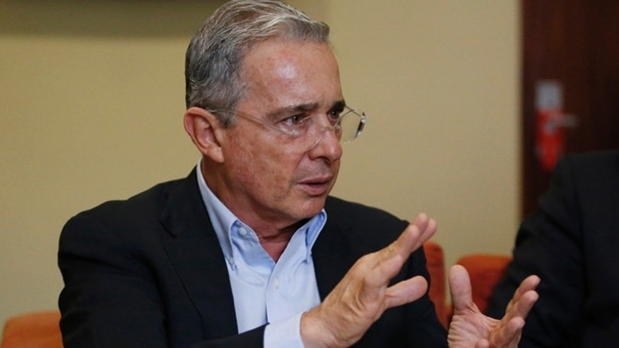 Alvaro Uribe gestures during an interview with the AP in Bogota, Colombia, Thursday, Oct. 1, 2015.