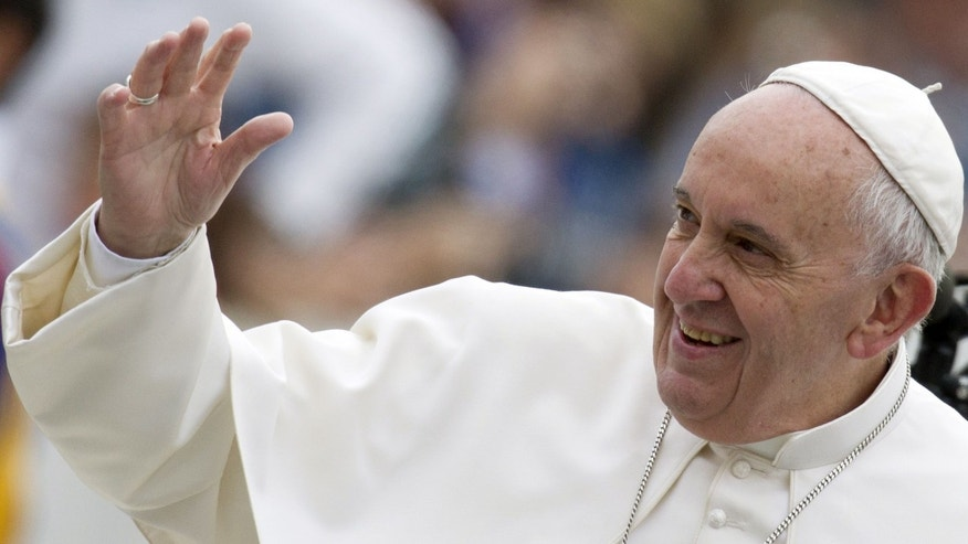Pope Francis waves to faithful as he arrives for his weekly general audience in St. Peter's Square, at the Vatican, Wednesday, Sept. 30, 2015. (AP Photo/Riccardo De Luca)
