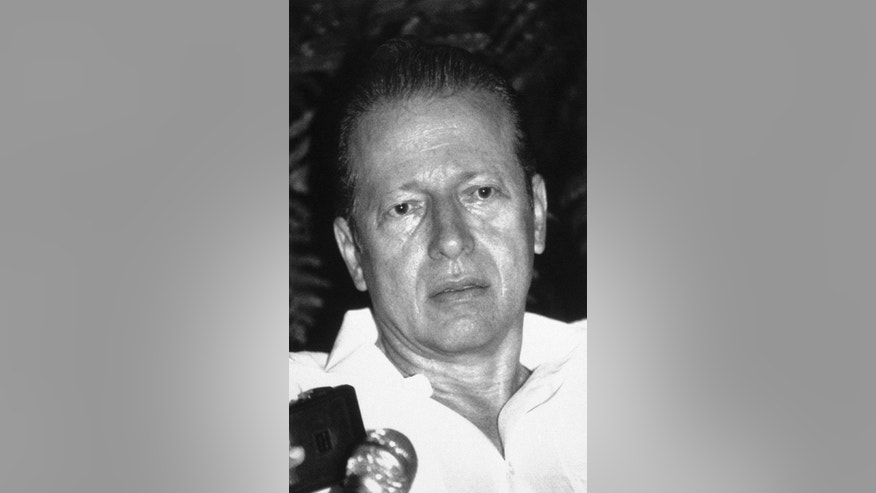 FILE - In this Feb. 25, 1988 file photo, Panama's President Eric Arturo Delvalle speaks with reporters at his home in Panama City after ordering General Manuel Antonio Noriega to step down as military chief. Delvalle died in Cleveland, Ohio, on Friday, Oct. 2, 2015. He was 78 years old. (AP Photo/Carlos Guardia, File)