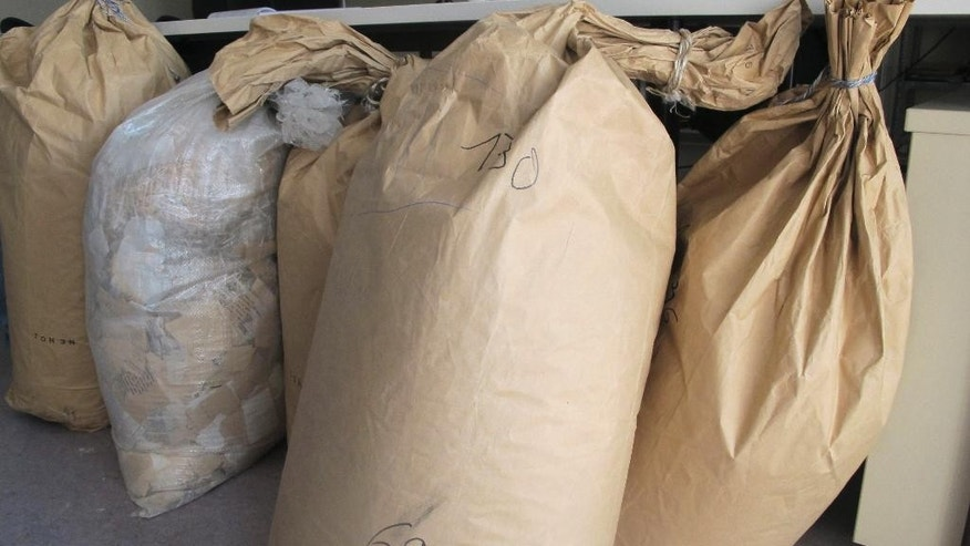 The Sept. 10, 2015 photo shows bags with pieces of files of former GDR secret police Stasi in Berlin. The Ministry for State Security, better known as the Stasi, used a network of agents and informers to collect details of almost every citizen in East Germany, to better quash dissent. When the communist regime collapsed, Stasi officials tried desperately to destroy the evidence of their totalitarian surveillance apparatus. (AP Photo/Frank Jordans)