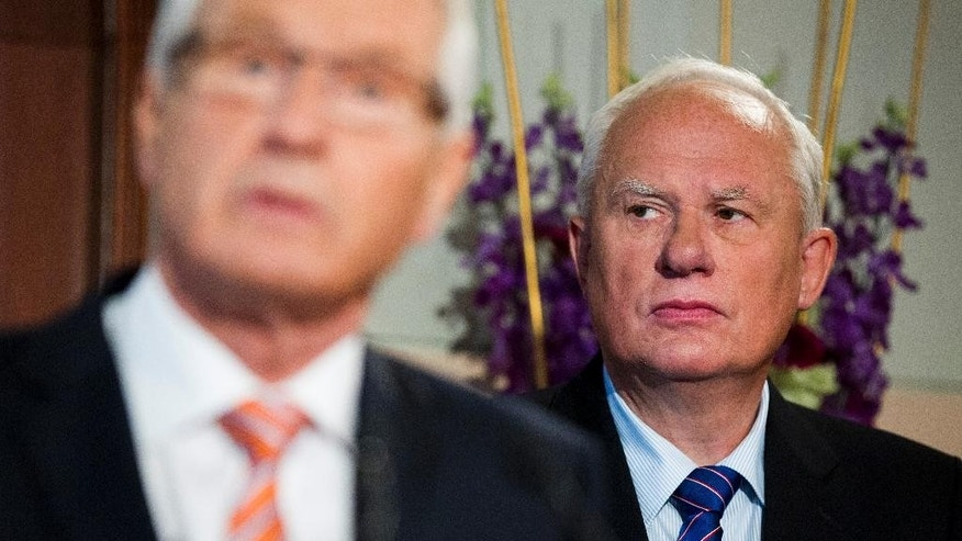 FILE - This is an Oct. 10, 2014 file photo of Geir Lundestad, right, the then secretary of the Norwegian Nobel Committee and  Thorbjorn Jagland, chairman of the Nobel Committee, during the announcement for the 2014 Nobel Peace Prize.  A book written by former secretary Geir Lundestad  detailing the secret tussles behind some of the most controversial Nobel Peace Prizes in the last quarter century is having its own disruptive effect on the 2015 award.  (Vegard Wivestad Grott/NTB scanpix, File via AP) NORWAY OUT
