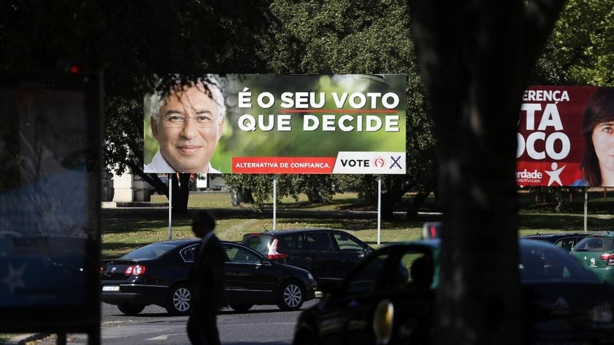 "Cars drive past an election campaign poster of the Portuguese Socialist Party in Lisbon Thursday, Oct. 1 2015. The poster shows a picture of party leader Antonio Costa and the slogan ""It's your vote that decides"". Ahead of Sunday's election, the center-right government is roughly level in polls with the Socialist Party, the main opposition, despite promising more frugality as the economy slowly emerges from a three-year recession. (AP Photo/Armando Franca)"