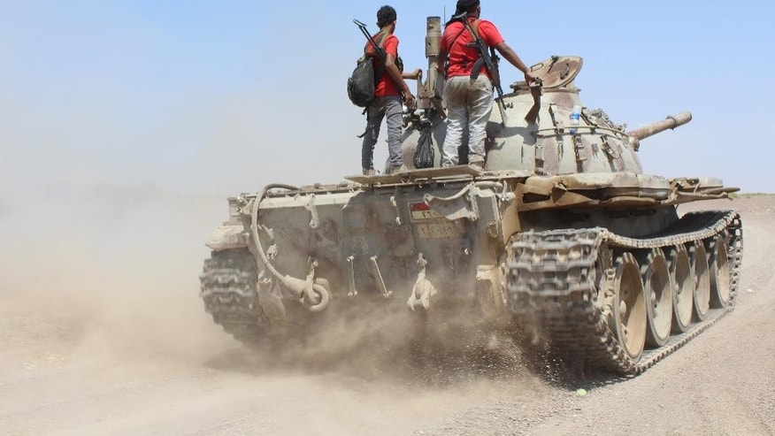 Fighters against Shiite rebels known as Houthis ride on a tank near the strait of Bab al-Mandab, west of the southern port city of Aden, to take back the control of the strait, Yemen, Friday, Oct. 2, 2015. Earlier in the day, pro- government forces captured a key Houthi encampment near the Bab al-Mandab straight, the strategic southern entrance to the Red Sea and the gateway to the Suez Canal, security officials said.  (AP Photo/Wael Qubady)