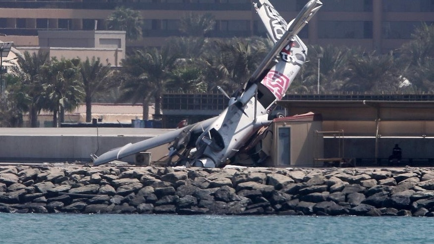 An aircraft belonging to a Dubai skydiving company is seen after crashing off the runway Friday, Oct. 2, 2015, in Dubai, United Arab Emirates. (AP Photo/Kamran Jebreili)
