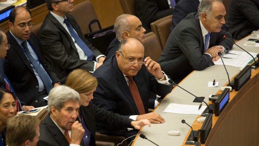 Oct. 2, 2015-  Egypt's Foreign Minister Sameh Shoukry speaks during a high-level meeting on Libya at the United Nations headquarters. U.S. Ambassador to the U.N. Samantha Power and Secretary of State John Kerry are to his right.