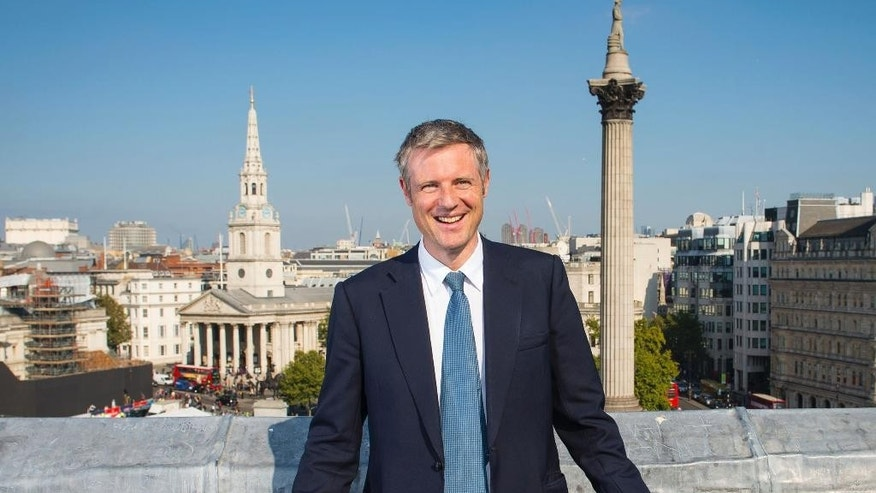 Conservative Party candidate for Mayor of London Zac Goldsmith, poses for the camera with Nelson's Column, right and St Martin's in the Field church, left, in the background in London Friday Oct. 2, 2015. The Conservatives said Friday that party members had chosen Zac Goldsmith in an online primary to fight the May 5 election against Labour's Sadiq Khan. (Dominic Lipinski/PA via AP ) UNITED KINGDOM OUT