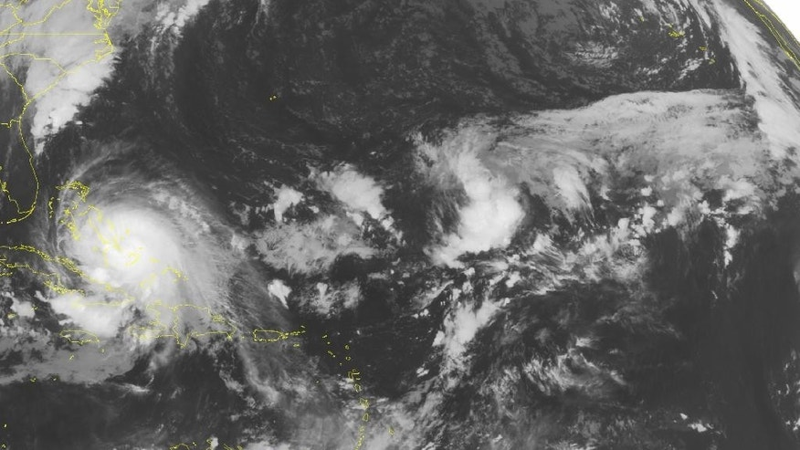 This NOAA satellite image taken Saturday, Oct. 3, 2015 at 12:45 AM EDT shows Hurricane Joaquin to the east of the Bahamas. Joaquin has sustained winds of 125 miles an hour and will move to the northeast away from the islands. Some showers and thunderstorms from the outer bands of Joaquin will affect Cuba and Hispaniola. Over the Lesser Antilles some typical pop-up showers and storms will occur. (AP PHOTO/WEATHER UNDERGROUND)
