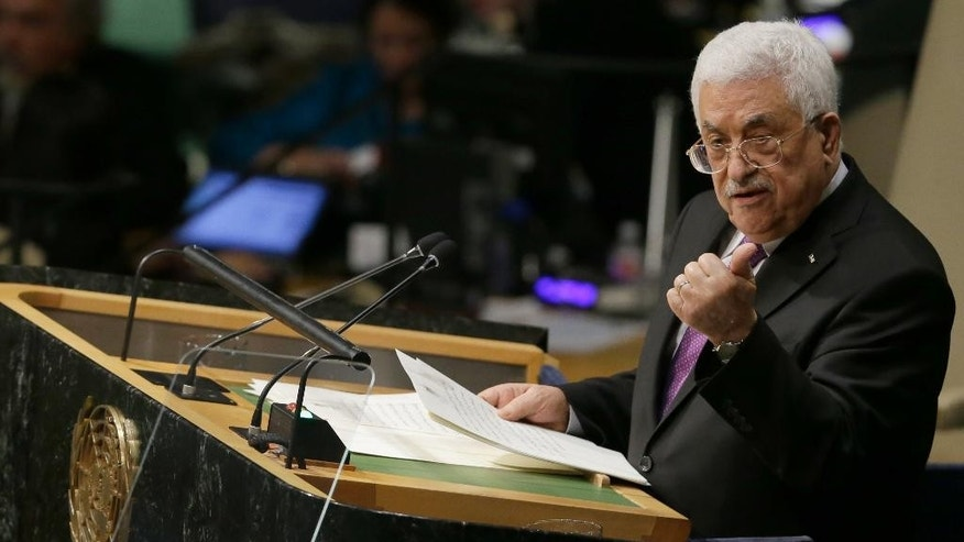 CORRECTS CAPTION TO REMOVE REFERENCE TO STATE OF PALESTINE IN ACCORDANCE WITH AP STYLE - Palestinian President Mahmoud Abbas addresses the 70th session of the United Nations General Assembly on Wednesday, Sept. 30, 2015 at U.N. Headquarters. (AP Photo/Mary Altaffer)